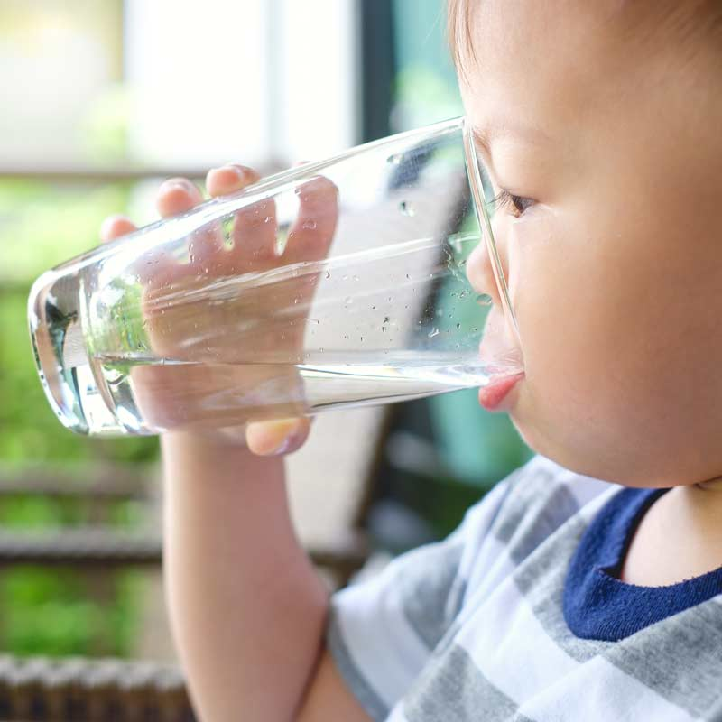 Safe clean drinking water rom the tap - Photo of child drinking a glass of water